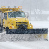 An INDOT snow plow drives southbound on Scatterfield as snow and high wind make for dangerous driving conditions in Anderson.