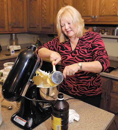 Terri Austin makes her mothers' favorite recipe, Mexican Wedding Cakes, for the Soroptimists Cookie Walk.
