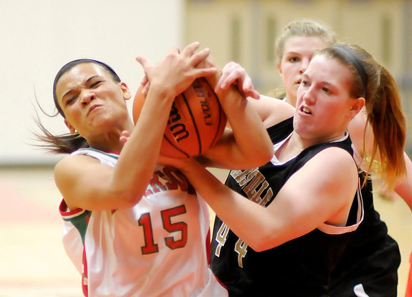 Anderson's Chelsea Bentley and Noblesville's Erin Flynn fight for control of the ball as the Indians hosted the Millers on Thursday.