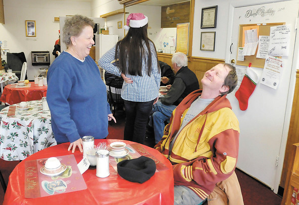 Betsy Stoops shares a laugh with Chuck Shigley at The Help Center in Anderson. The Help Center is a faith based program reaching out to area homeless located at 1103 Main Street next to the CATS station.