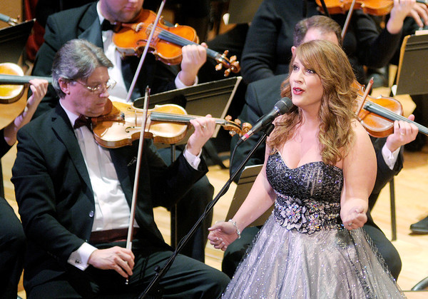Don Knight / The Herald Bulletin<br /> Vocalist Heather Bays performs with the Anderson Symphony Orchestra during their Christmas concert on Saturday. The ASO's next performance will be their Sandi Patty Valentine's Concert on February 15th.