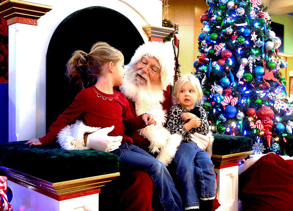 THB photo/John P. Cleary<br /> Santa (David Cunningham) talk to Lilly Semler, 5, and her little sister Briella, 3, as they came to the Mounds Mall to visit Santa.