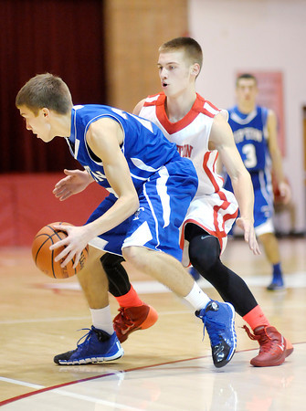 Don Knight / The Herald Bulletin<br /> Frankton's Nick Wright guards Tipton's Jon Ross as the Eagles applied full court pressure on the Blue Devils Saturday.