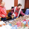 Don Knight / The Herald Bulletin<br /> Doug and Theresa Shaw look at the Jacobs Country Candles and Tarts table during the Mistletoe Magic Christmas Market at the City Building in Elwood on Saturday.