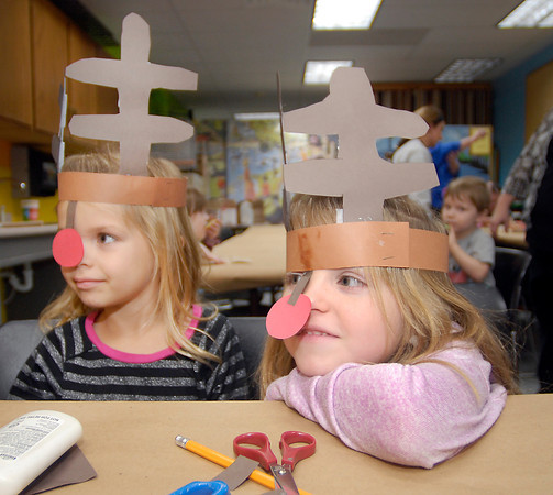 THB photo/John P. Cleary<br /> Taylor Bastin, 5, and her twin sister Kaylee, show off their reindeer antlers they had made as part of the Winterfest craft activities Friday evening at the Anderson Center for the Arts.  The girls were part of Girl Scout Daisy Troop 3326 from McCordsville.