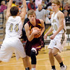 THB photo/John P. Cleary<br /> Alexandria's Braden Warren protects the ball as he drives through Lapel defenders Bobby Steele and Bailey Partington.