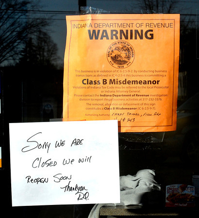Don Knight / The Herald Bulletin<br /> Dairy Queen on 53rd street in Anderson is<br />  temporarily closed. These signs were posted on the front door of the business.