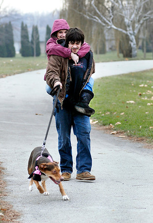 THB photo/John P. Cleary<br /> John Howard and Courtney Malston have some fun with each other as they walk John's dog Chief through Pulaski Park Monday afternoon enjoying the warmer temperatures.