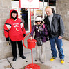 Don Knight / The Herald Bulletin<br /> Anita Slaymaker and Kenny Zachary make a donation to the Salvation Army's Red Kettle drive in front of the Mounds Mall as Bell Ringer Frankie Smith looks on on Saturday.