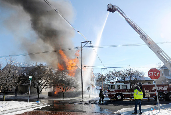 Don Knight / The Herald Bulletin<br /> AFD battles a house fire on 11th Street on Thursday. Residents in six apartments were displaced.