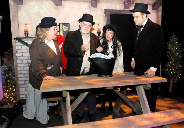 """Don Knight / The Herald Bulletin<br /> From left, Jane Cornelious, Bill Malone, Sarah Asnicar and Tommy Thomas perform in Madison Park Church of God's annual production of """"A Christmas Carol."""" The show runs the 13th through the 15th at 7 p.m. and a matinee show Saturday at 2 p.m."""