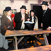 "Don Knight / The Herald Bulletin<br /> From left, Jane Cornelious, Bill Malone, Sarah Asnicar and Tommy Thomas perform in Madison Park Church of God's annual production of ""A Christmas Carol."" The show runs the 13th through the 15th at 7 p.m. and a matinee show Saturday at 2 p.m."
