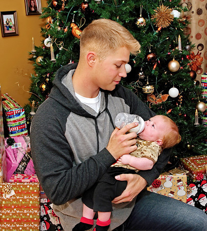 Mark Maynard/For The Herald Bulletin<br /> Marine  Corporal Sanson Pittman feeding his two-month old son Sawyer, whom he met for the first time on December 24th when he returned home after being deployed in Afghanistan.