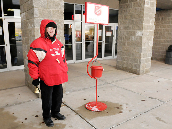 Don Knight / The Herald Bulletin<br /> Salvation Army bell ringer Frankie Smith works in front of Mounds Mall on Saturday. Smith has been working as a bell ringer since 1985.