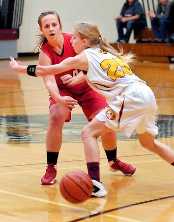THB photo/John P. Cleary<br /> Frankton's Ashtyn Rastetter passes the ball under the outstretched arm of Alexandria defender Kelsey Crisp.