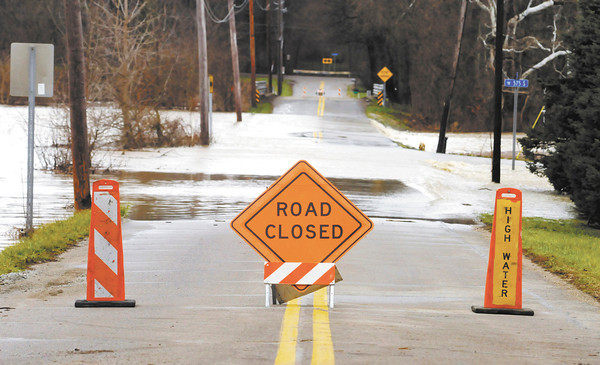 Don Knight / The Herald Bulletin<br /> County Road 50 West was closed due the flooding of Fall Creek on Sunday.
