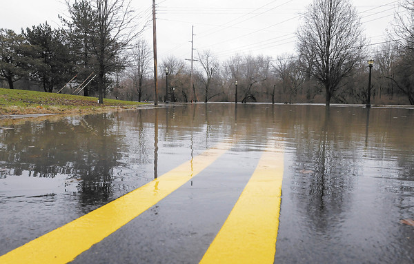 Don Knight / The Herald Bulletin<br /> Grand Avenue in Anderson was closed due to flooding of the White River on Sunday.