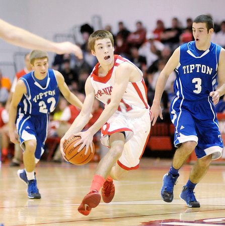 Don Knight / The Herald Bulletin<br /> Frankton's Austin Compton drives to the basket as the Eagles hosted Tipton on Saturday.