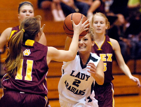 Alexandria's Morgan Oliver gets a hand on the ball as Pendleton's Kelsee Wendling tries to drive the lane.