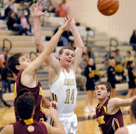THB photo/John P. Cleary<br /> Lapel's Mitchell Richardson, #14, gets the ball knocked out of his hands by Alexandria's Jonah Jerrils as he drives into the lane.