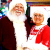THB photo/John P. Cleary<br /> Santa and Mrs. Claus (David Cunningham & Susan Adams) greet children at Mounds Mall.