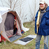 THB photo/Traci Moyer<br /> Michael Camp, a 57 year-old homeless military veteran, fights off the cold in this tent he erected behind Marshalls on Scatterfield Road.