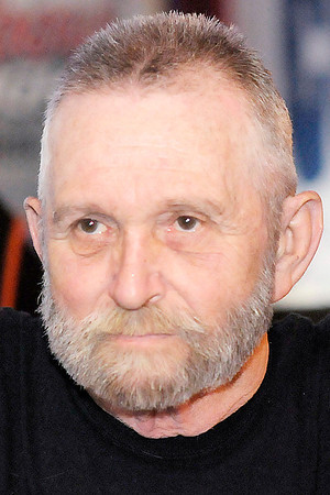 Don Knight / The Herald Bulletin<br /> Vietnam Veteran Stan Rockhold agreed to cut his hair and beard if $500 in donations could be raised for the Toys for Tots charity.