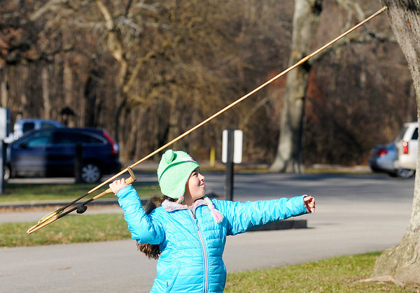Don Knight / The Herald Bulletin<br /> Lucy Wilhoite, 10, uses an Atl Atl at Mounds State Park on Saturday. Mounds State Park Naturalist Leah Perry was teaching park visitors how to using the hunting tool.