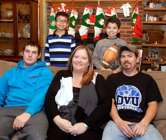 THB photo/John P. Cleary<br /> The Allender family: seated is CJ, 19, and Christy and Carl Allender.  Standing are Kadan, 12, and Juian, 11.