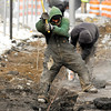 THB photo/John P. Cleary<br /> Partners-N-Concrete, of Anderson, tear out the sidewalks along the east side of the Anderson City Building. Here Larry Kayzer uses a pickaxe to breakup pieces of the old sidewalk as work started Tuesday and new sidewalks on the east and part of the north side of the building that should be done by the end of the week.