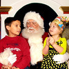 THB photo/John P. Cleary<br /> Santa (David Cunningham) listens as Landon Mathes, 7, and Payton Melvin tell him what they would like for Christmas as they visit Santa at the Mounds Mall.