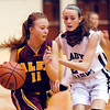 Alexandria's Morgan Oliver drives into the lane as Molly Bradfield of Pendleton defends.