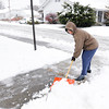 Don Knight / The Herald Bulletin<br /> Ruthe Coleman shovels the snow from the sidewalks around her home on Saturday.