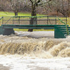 Don Knight / The Herald Bulletin<br /> The foot bridge over Fall Creek at Falls Park in Pendleton was surrounded by flood waters on Saturday. Fall Creek and the White River are forecast to crest on Sunday.