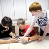 Don Knight / The Herald Bulletin<br /> From left, Justin Stiers, Matthew Childs and Keegan Brown work on a control panal for a water purification system during a youth group lock-in at First United Methodist Church.