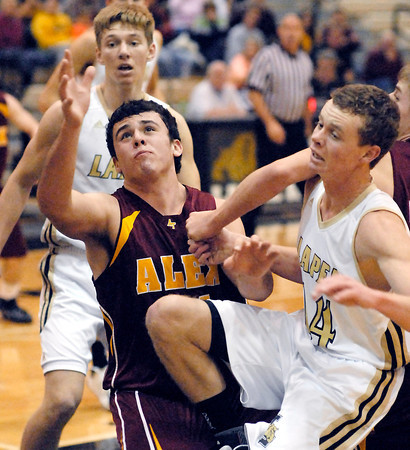 THB photo/John P. Cleary<br /> Alexandria's Jake Thurston loses the ball as he collides with Lapel's Mitchell Richardson while driving to the basket.