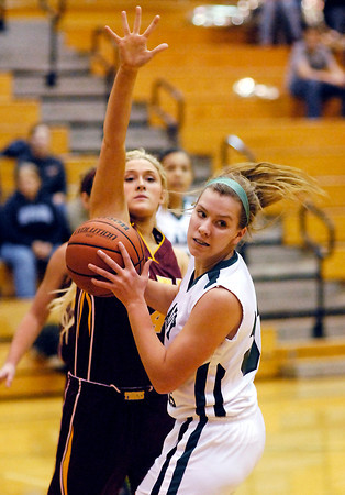 Alexandria's Kennedy Aiman comes in to defend Adrianne Phillips of Pendleton after she got an offensive rebound.