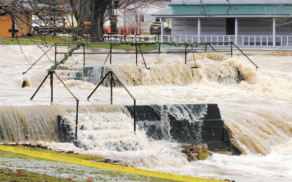 Don Knight / The Herald Bulletin<br /> Falls Park was closed to traffic to keep curious onlookers from getting to close as Fall Creek flooded on Sunday.