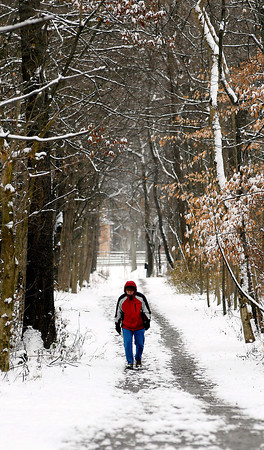 THB photo/John P. Cleary<br /> With fresh snow and cold temperatures you had to be bundled up out walking the trails in Mounds State Park.