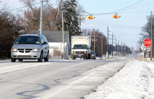 Don Knight / The Herald Bulletin<br /> Traffic travels on Indiana 13 south of Lapel on Saturday. A group of homeowners worried about being annexed into Anderson have signed petitions asking to be incorporated into Lapel's city limits.