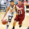 Don Knight / The Herald Bulletin<br /> Anderson's Micah Smith drives as he is guarded by Rose-Hulman's Jordy Martin  on Wednesday.
