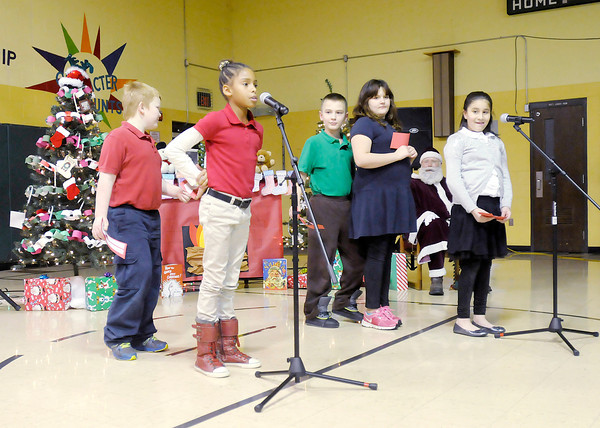 """Don Knight / The Herald Bulletin<br /> Tanyuel Welch recites part of the poem """"The Night Before Christmas"""" as Edgewood Elementary held their Christmas program on Friday."""