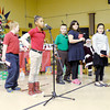 "Don Knight / The Herald Bulletin<br /> Tanyuel Welch recites part of the poem ""The Night Before Christmas"" as Edgewood Elementary held their Christmas program on Friday."