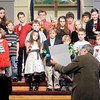 Don Knight / The Herald Bulletin<br /> The youth at Fall Creek Christian Church perform a song with hand bells during the church's Christmas Eve service on Tuesday.