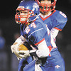 File photo/The Herald Bulletin<br /> Sammy Mireles takes the hand off from quarterback Alex Mireles as Elwood hosted Alexandria for the sectional semi-final on November 1, 2013.