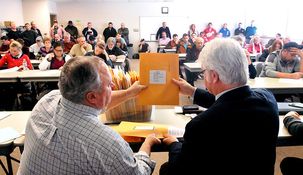 THB photo/John P. Cleary<br /> Opening of sealed bids for the new Ivy Tech building in Anderson.