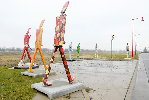 Don Knight / The Herald Bulletin<br /> Walking Man statues stand at the intersection of 29th St. and Dr. Martin Luther King Jr. Boulevard on Wednesday ahead of a RACER Trust meeting scheduled for Thursday.