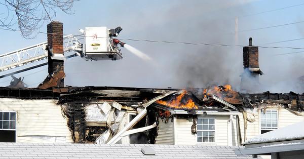 Zach Osowski / The Herald Bulletin<br /> Fire destroys apartments at 2608 Columbus Avenue on Thursday.