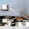 Zach Osowski / The Herald Bulletin<br /> Fire destroys apartments at 2608 Columbus Avenue on Thursday.