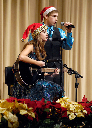 """THB photo/John P. Cleary<br /> Paige Hendershot and Devin Norrick sang """"Christmas in the Sand"""" during the Lapel High School Music Department's annual holiday show, """"Celebrate Christmas"""" Monday evening."""